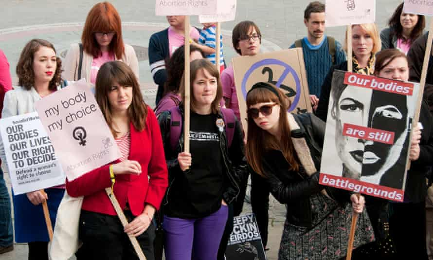 """Pro-Choice campaigners at a rally hold sign saying, """"My body, my choice."""""""