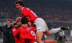 Andy Cole celebrates his goal with Manchester United teammates.