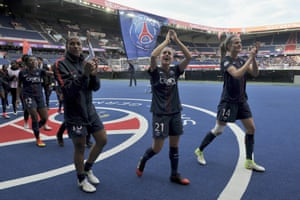 Marie Laure Delie, Veronica Boquete and Irene Paredes of Paris Saint-Germain salute supporters after the Women's Champions League match against Barcelona on 29 April 2017.