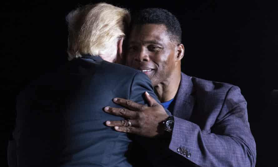 Trump hugs Georgia Senate candidate Herschel Walker.