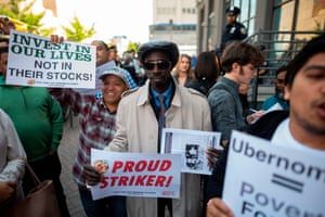 Drivers take part in a rally demanding more job security and liveable incomes at Uber and Lyft Headquaters