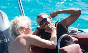 Obama and Branson wrestle on a boat