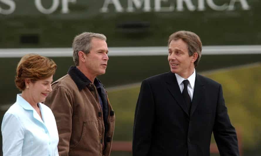 President Bush and first lady Laura Bush greet Tony Blair on his arrival at the Bush ranch in 2002