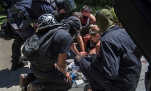 A victim is attended after he was stabbed during a rally at the state capitol in Sacramento on Sunday.
