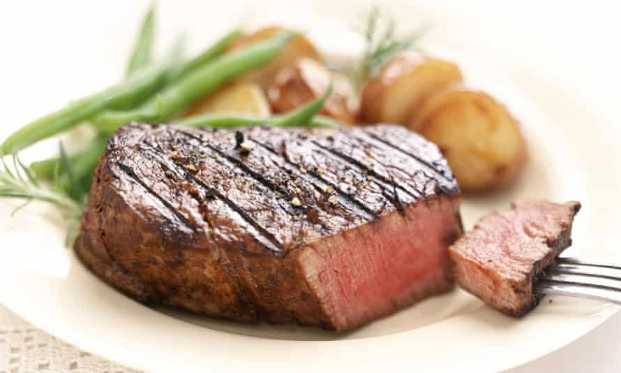 A plate with a steak on it
