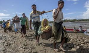 Rohingya Muslims walk to a refugee camp in Bangladesh