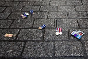 Medals lie on the ground after being discarded by military veterans