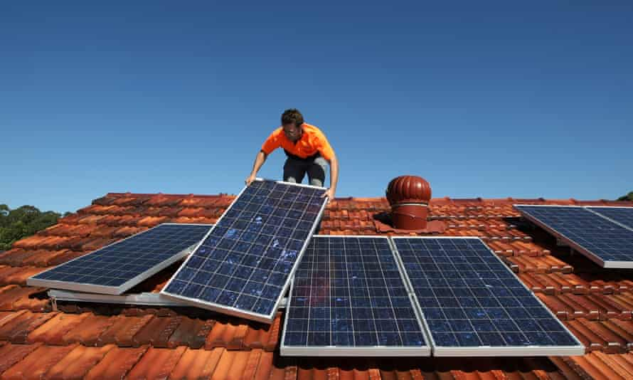 Solar panels are installed on to the roof of a house in Sydney, Australia. Almost 90% of new electricity generation in 2020 will be renewable, the IEA says.