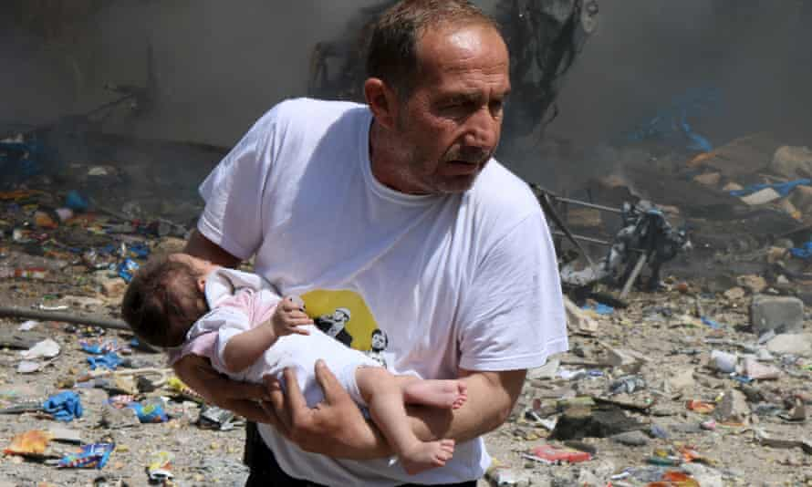 A rescued baby from what activists said was a site hit by a barrel bomb dropped by forces loyal to Syrian president Bashar al-Assad in Aleppo.
