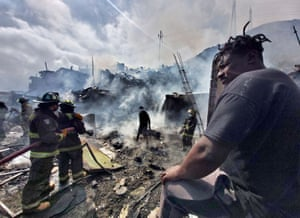 Antofagasta, ChileFirefighters work to put out a fire that affected dozens light material homes at two migrants' camps
