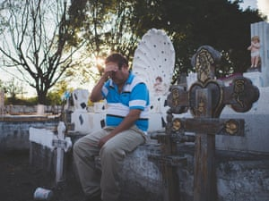 Mexico; Guerrero; Iguala; 2018 Mr Rogelio by his wife and his son's graves. His son disappeared in 2012 and was found dead the year after. His girlfriend had connections with the local drug cartel and was probably the one who had him killed after he refused to pay a money extortion. Like many other people, Mr. Rogelio had to personally search for his son.