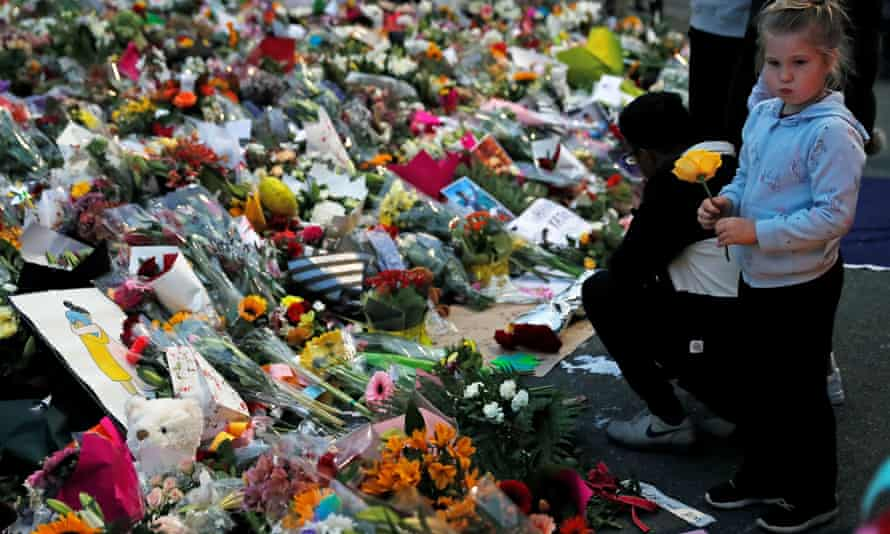FILE PHOTO: People visit a memorial site for victims of Friday's shooting, in front of the Masjid Al Noor mosque in Christchurch, New Zealand March 18, 2019. REUTERS/Jorge Silva/File Photo