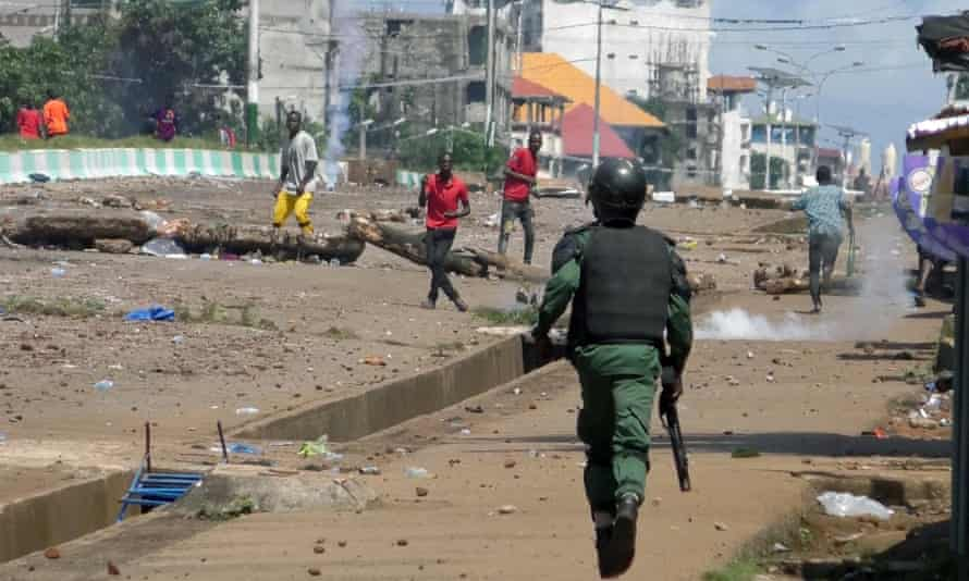Supporters of opposition leader Cellou Dalein Diallo clash with security forces after election results in Conakry.