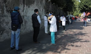 People wait in line before healthcare worker take samples for the coronavirus test at Coayoacan park, in Mexico City, Mexico, on 22 October.