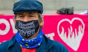 A demonstrator in Trafalgar Square protests against Dominic Cummings' visit to Durham during lockdown.