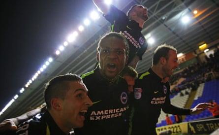 Brighton players celebrate after Glenn Murray's last-gasp winner.