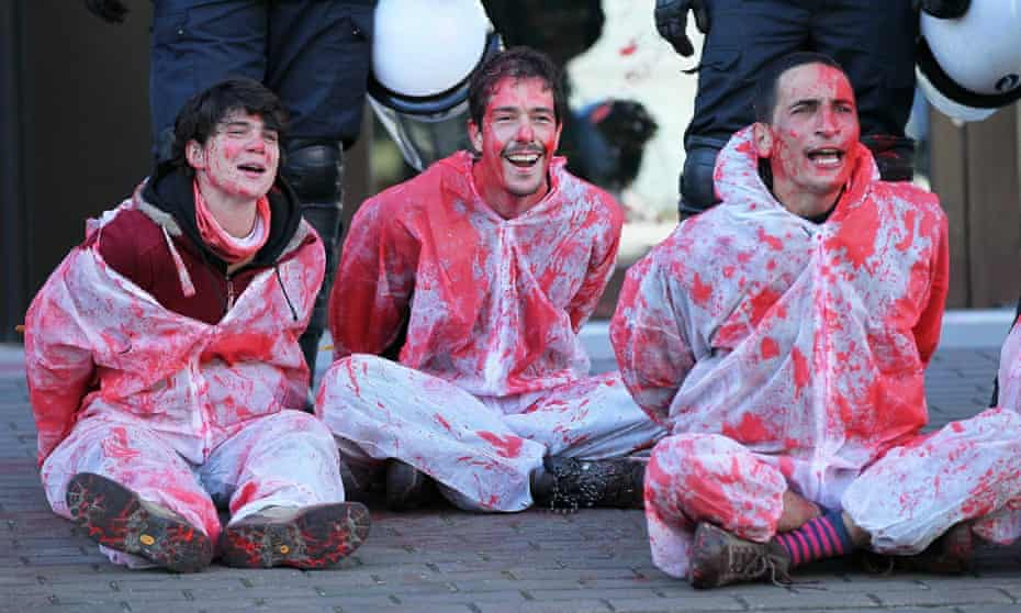 Activists in suits splattered with fake blood take part in protests against the Comprehensive Economic and Trade Agreement in front of the EU council building in Brussels last month.