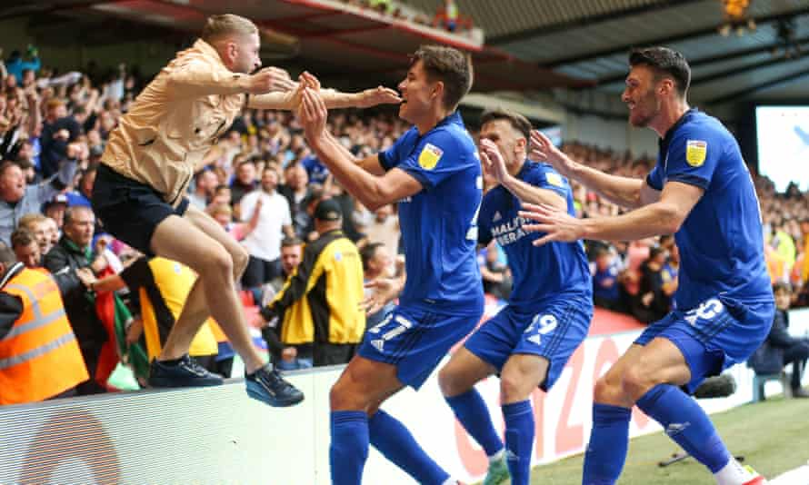 Rubin Colwill is greeted by a Cardiff fan as he celebrates after scoring the team's winner at Nottingham Forest.