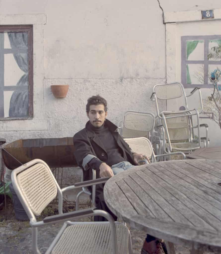 Seb Varela in his 'outdoor living room' on a street overlooking downtown Lisbon. His family is considered fado royalty because his great aunt was Amália Rodrigues, the central figure of 20th century fado.