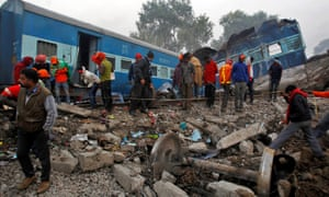 Rescue workers search for survivors at the site of the derailment in Pukhrayan, south of Kanpur city