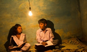 Light fantastic … young students in rural India settle in for a night's reading beneath an overhead light