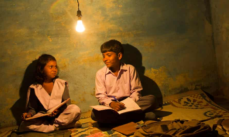Students reading at night in India