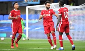 Sadio Mané celebrates with Roberto Firmino and Mo Salah after Liverpool's second goal