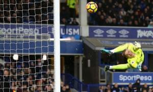 Goalkeeper Jordan Pickford of Everton looks back as he watches Juan Mata's shot hit the post.