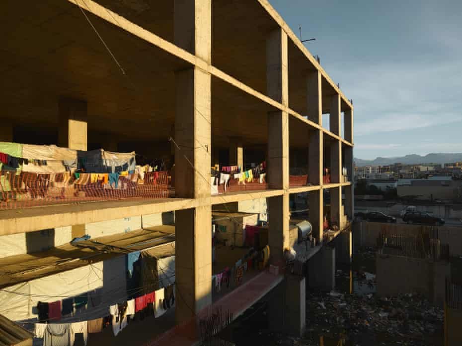 Clothes hang to dry in uncompleted concrete structure lived in by Yazidi refugees in Zakho, Dohuk governorate, in Iraqi Kurdistan.