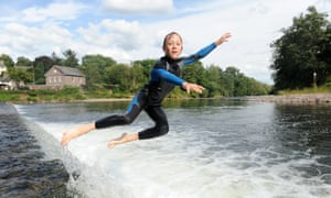 Jumping off the weir on the Usk at Crickhowell.