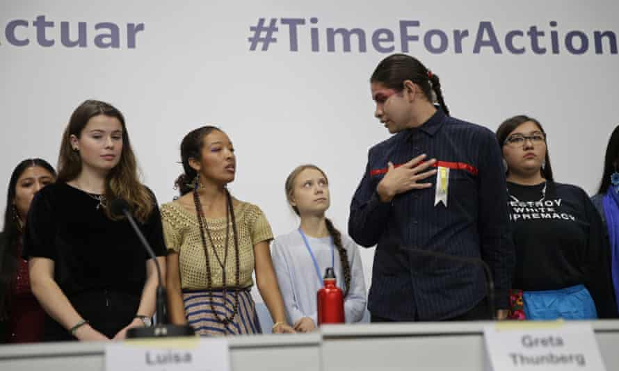 Greta Thunberg stands with other young activists at the COP25 summit in Madrid
