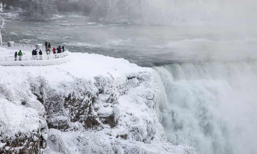 People visit the Niagara Falls during extreme cold weather as sub-zero temperatures are expected across Canada and the United States on New Year's day.
