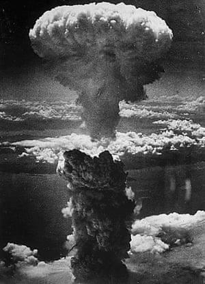 The mushroom cloud: a dense column of smoke rises more than 60,000ft into the air over Nagasaki.