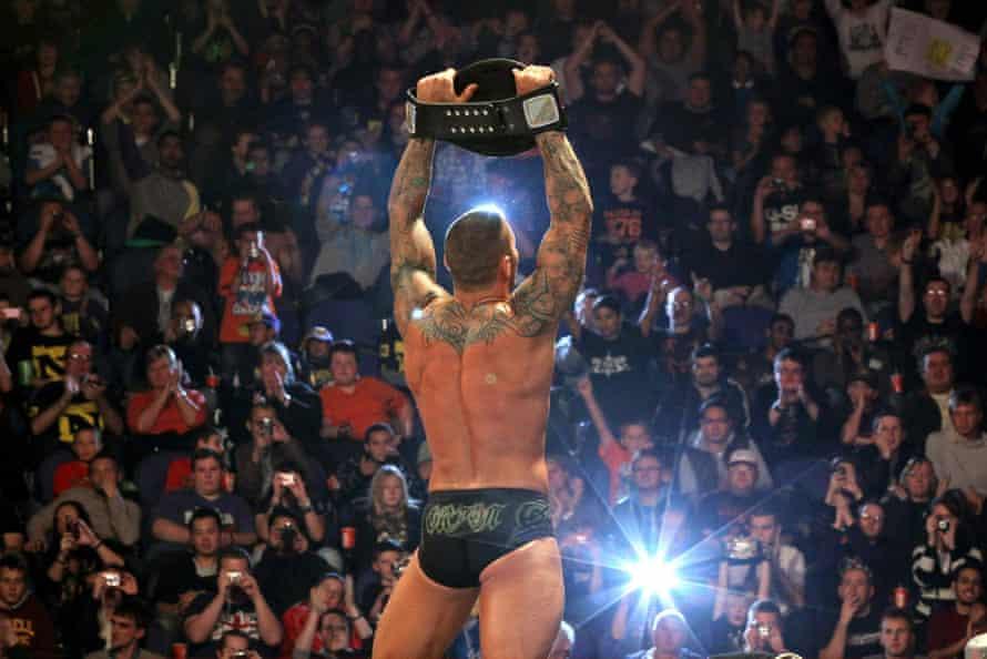 Pecs appeal: Randy Orton holds a WWE title belt aloft
