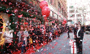 Queue of people with red balloons and confetti