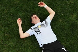 Germany midfielder Sebastian Rudy lies bloodied and awaits medical attention following a nasty collision against Sweden in Sochi.
