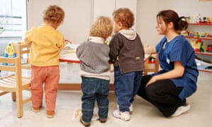 Childcare workers with kids at childcare centre