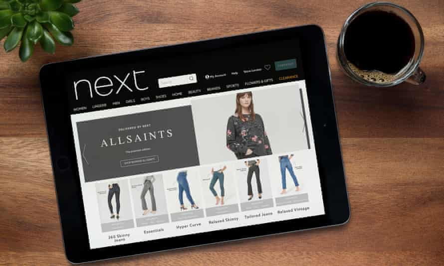 An iPad showing All Saints jeans on the Next website