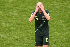 Australia's midfielder Aaron Mooy reacts after fizzing a shot just over the bar.