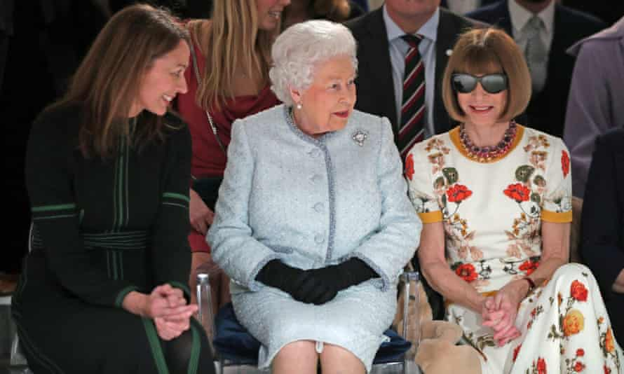 Wintour sits next to Caroline Rush, chief executive of the British Fashion Council, and the Queen on the front row at Richard Quinn's show, London fashion week 2018.