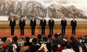 The all-male politburo standing committee greet the media in November 2012 in Beijing, China.