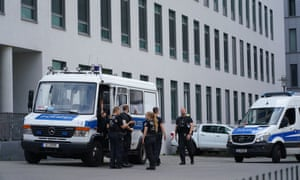 Police stand outside Charité hospital in Berlin, where Alexei Navalny is being treated.