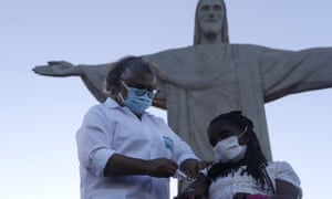 Terezinha da Conceicao, 80, is the first woman in Brazil to receive the Covid-19 vaccine produced by China's Sinovac Biotech Ltd, during the start of the vaccination programme which was launched in front of the Christ the Redeemer statue, Rio de Janeiro.