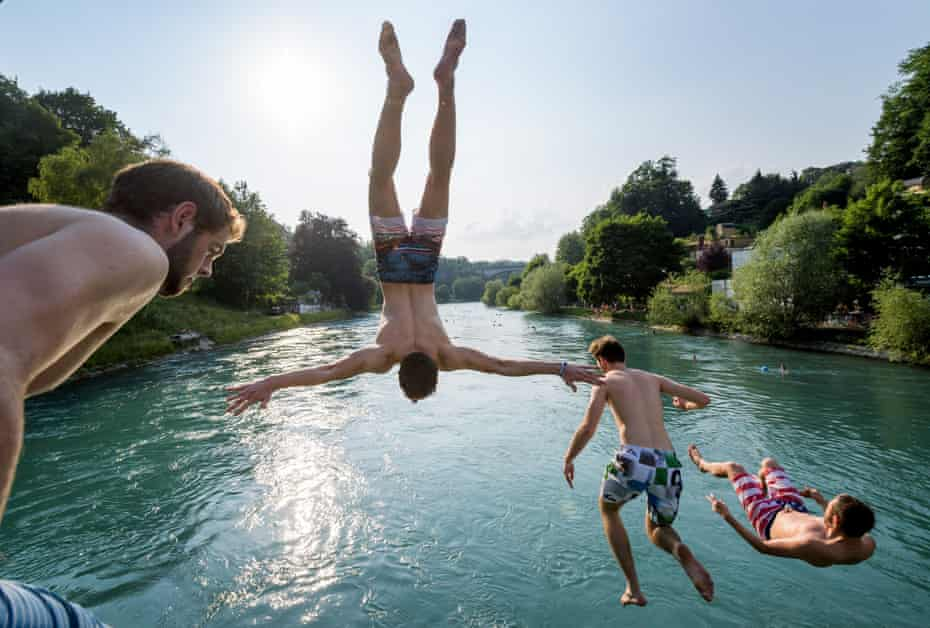 - Young men jump into the river Aare on June 21, 2017 in Bern