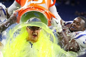 Head coach David Cutcliffe of the Duke Blue Devils is given a sticky bath after defeating the Northern Illinois Huskies