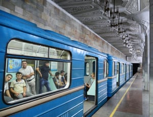 Commuters peer out at the novel sight of a foreigner taking photos of their metro