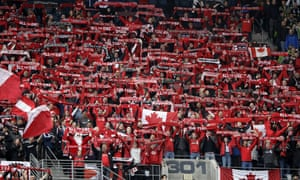 Toronto FC fans cheer Sunday, Nov. 10, 2019, at the MLS Cup championship soccer match between the Seattle Sounders and Toronto FC in Seattle. (AP Photo/Elaine Thompson)