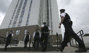 Police officers at Dorney Tower in Camden, London,  after the building was evacuated due to fire safety concerns, June 2017