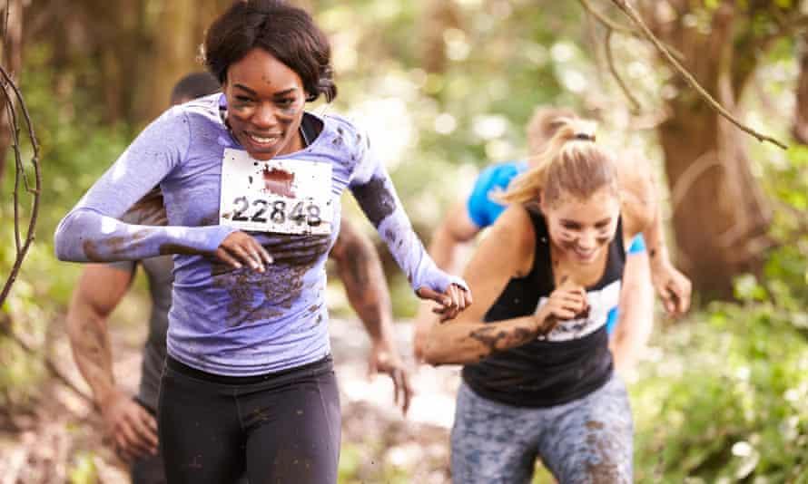 Two women enjoy a run in a forest at an endurance event