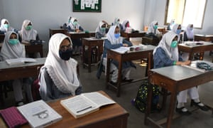 Students attend their first class at a reopened secondary school in Karachi, Pakistan, on Tuesday.